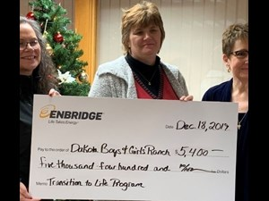 Enbridge donated $5,400 for a Minot DMS Transition to Life Program
